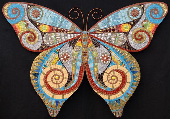 马赛克拼贴创意而成的蝴蝶图案艺术图片